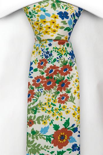 Bomull Guttelsips junior, Gule, blå og rødbrune blomster på hvitt