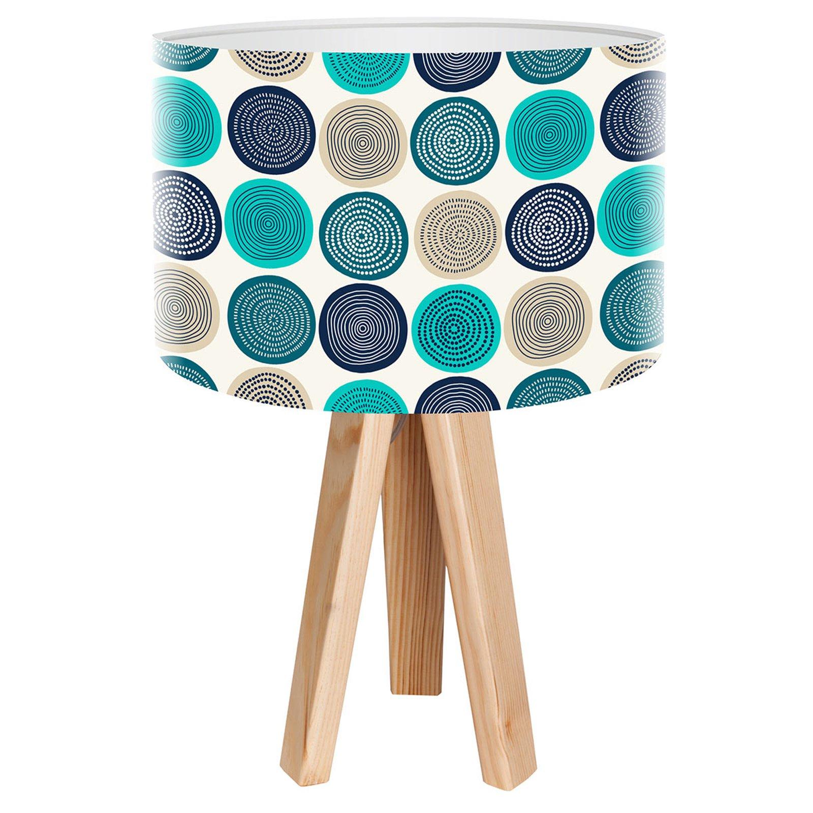 Aqua trebeinet bordlampe med trykket motiv