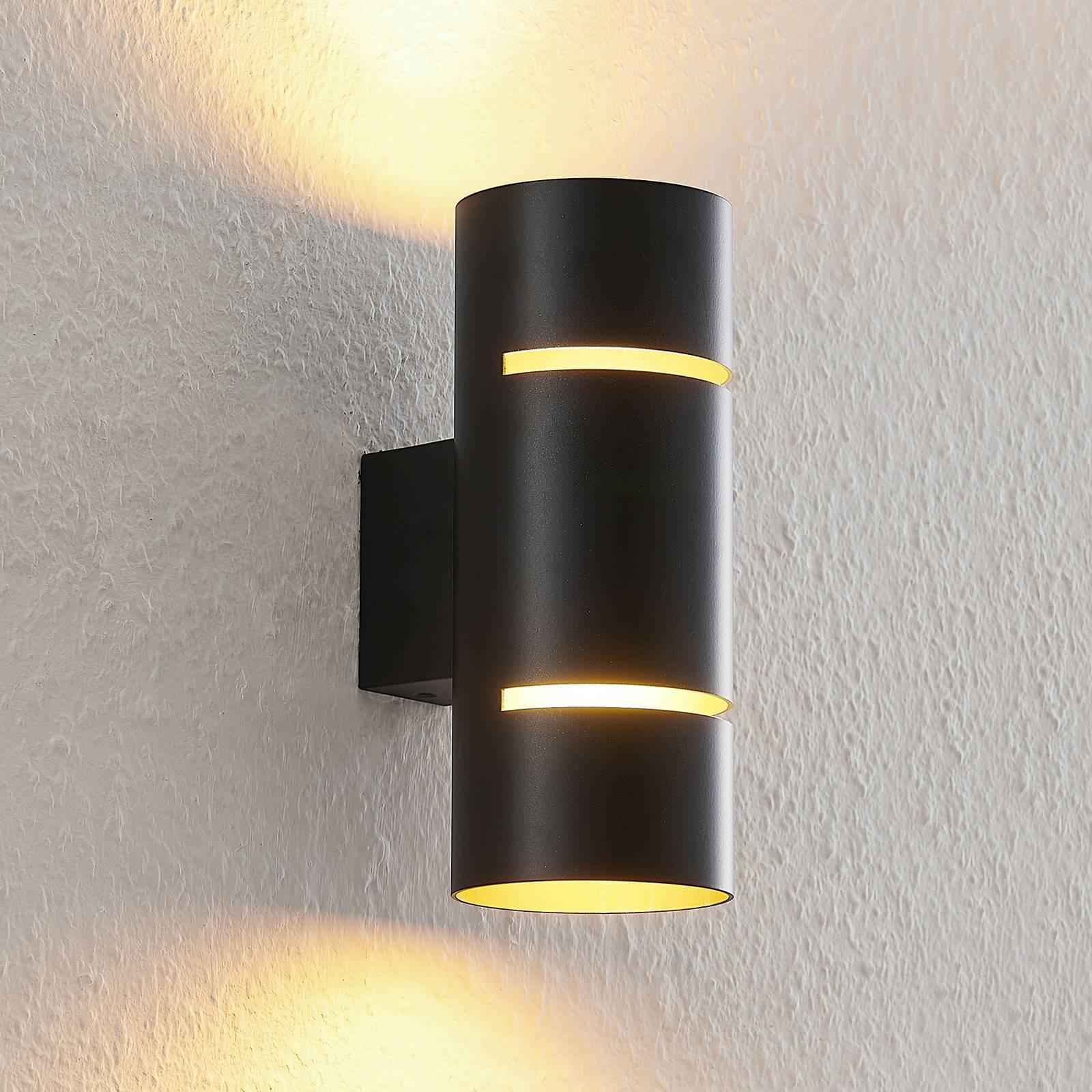 Lindby Deora-LED-seinävalaisin pyöreä musta-kupari