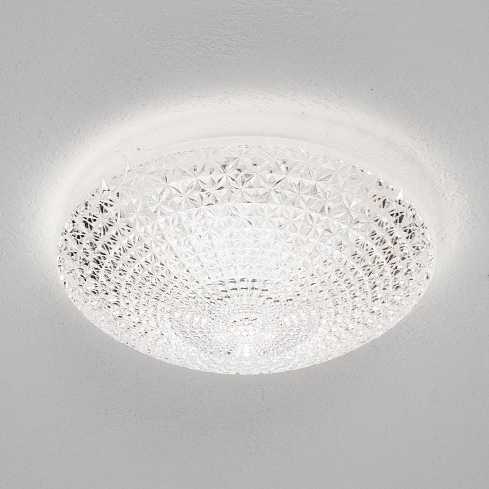 Kuorenpuolikkaan muotoinen LED-kattovalaisin Kuma