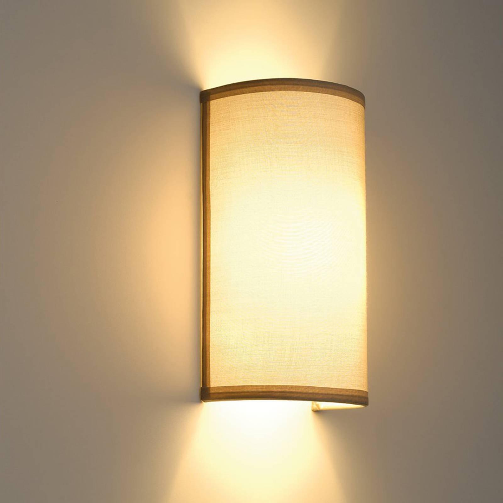 Mykt lys som stråler fra vegglampen Soprana