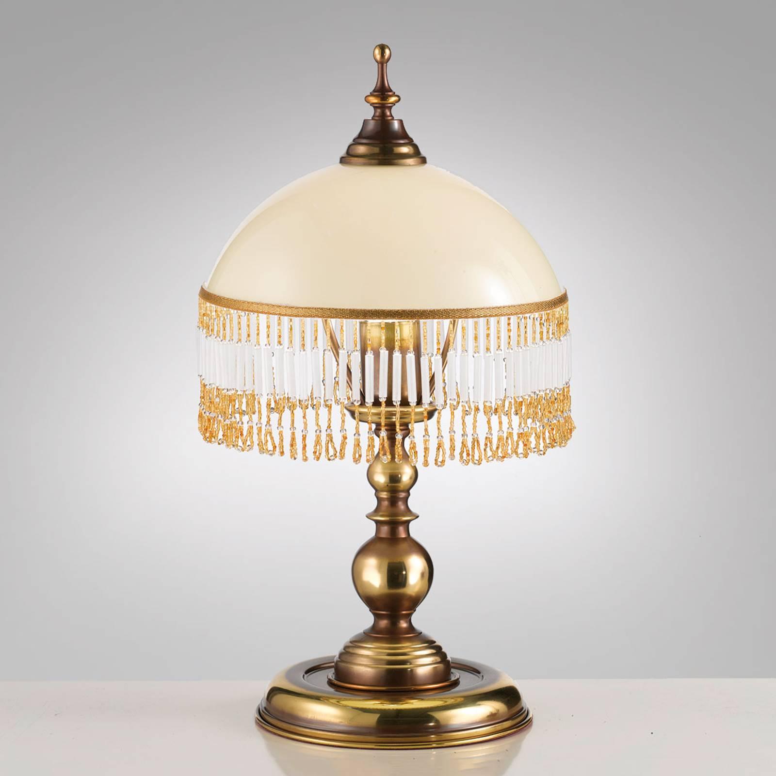 Corola – pöytävalaisin, jossa on kaunis koristelu