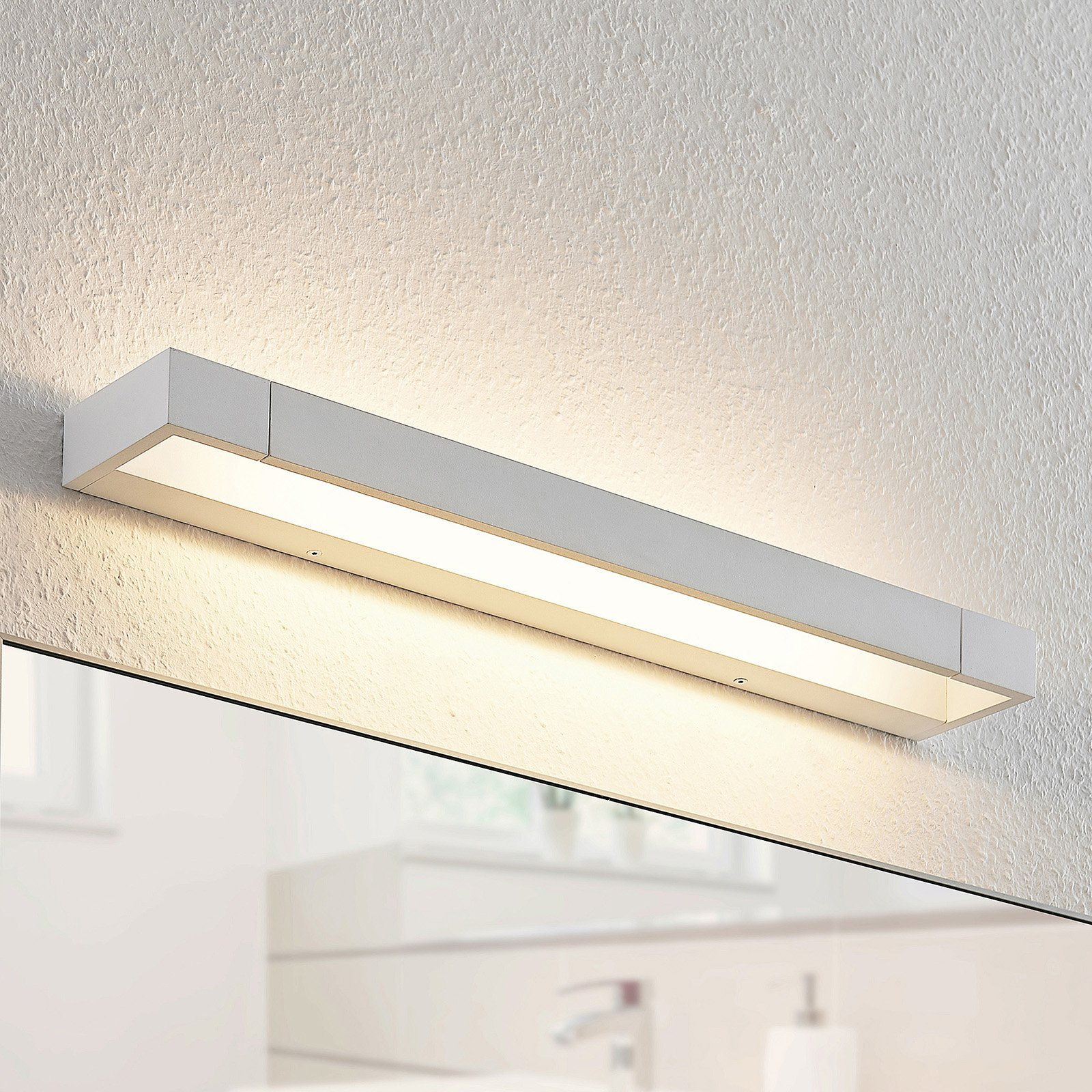 Arcchio Jora LED-vegglampe, IP44, hvit, 60 cm
