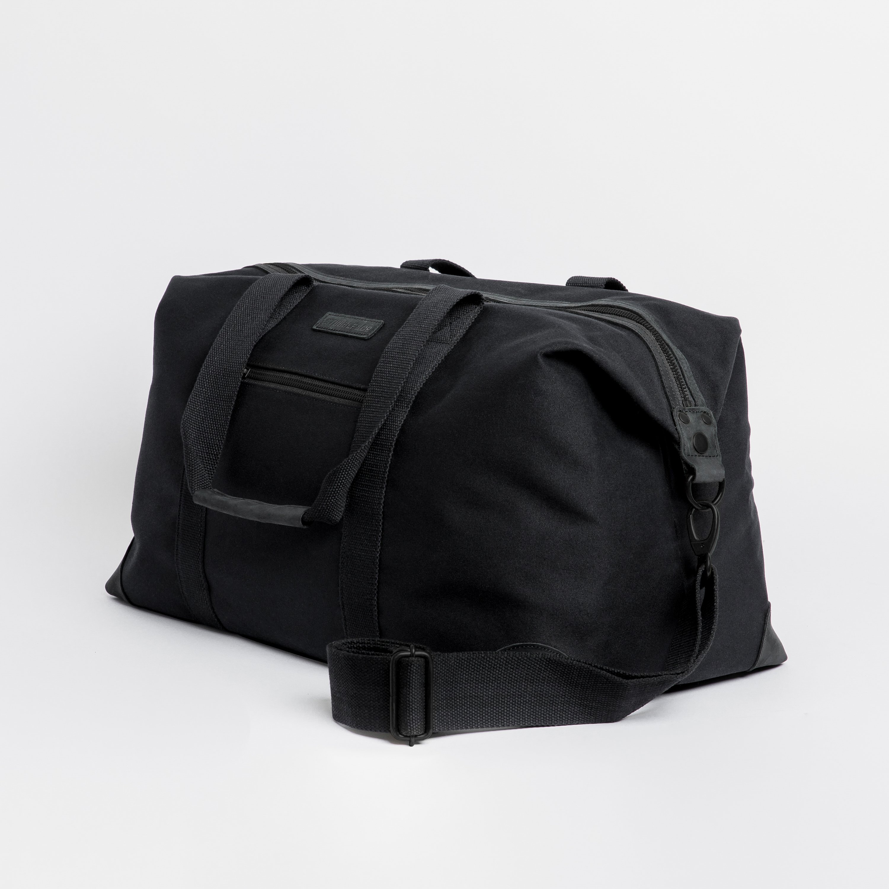 """The Weekender. Waterproofed Canvas and Leather Holdall. 15"""" Laptop Pocket., All Black"""