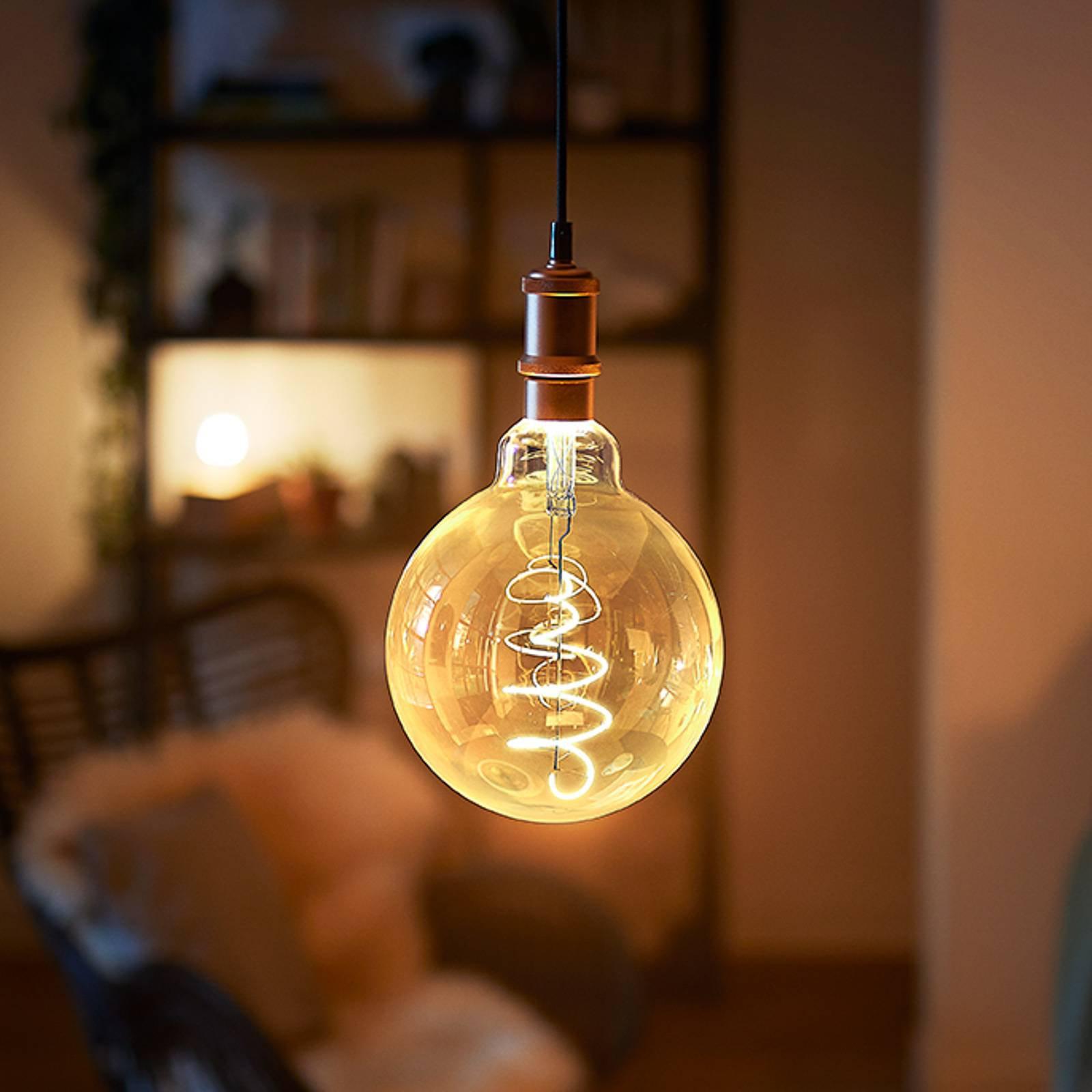 Philips LED-globepære E27 G95 5,5 W 2 000 K gull