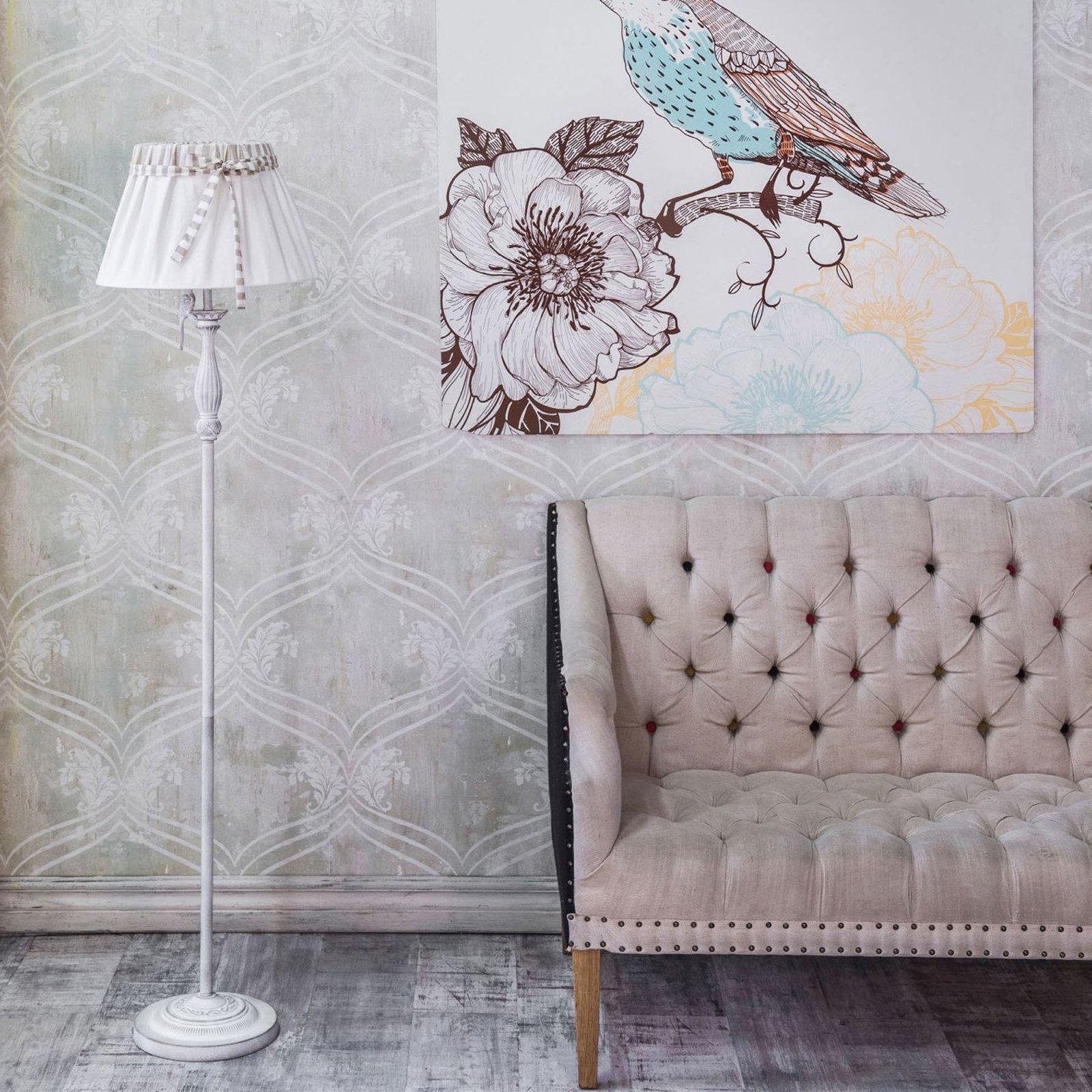Gulvlampen Bird er dekorert med en liten fugl