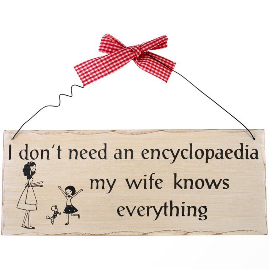 Träskylt - My wife knows everything