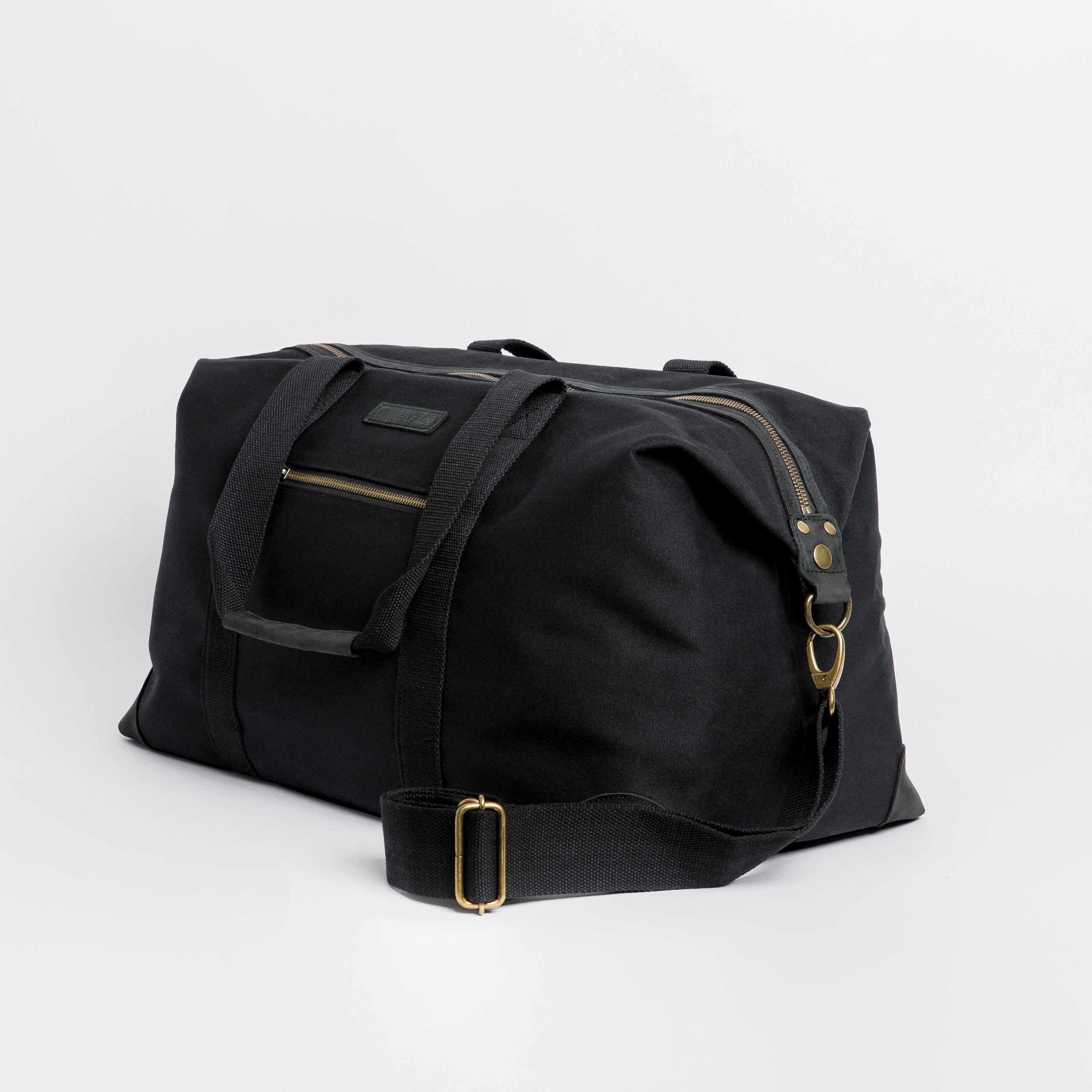 """The Weekender. Waterproofed Canvas and Leather Holdall. 15"""" Laptop Pocket., Black"""