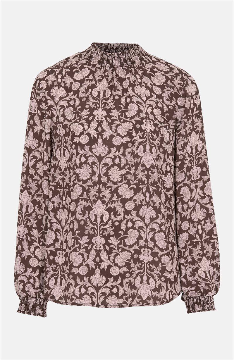 Kuviollinen pusero, jossa smokkipoimutettu kaulus