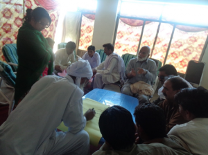 Saima delivering a session with traditional leaders using techniques learnt at the Tostan training.