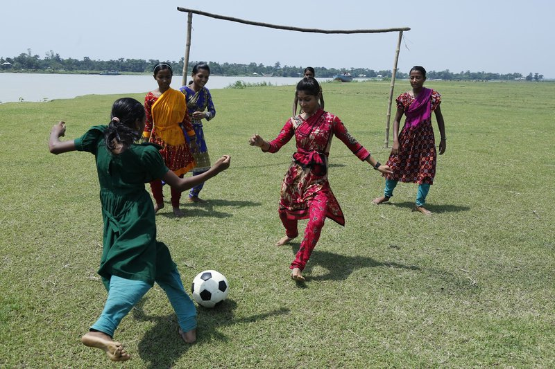 Girls playing football