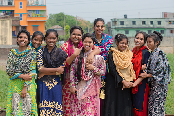 A group of adolescent girls smiling outdoors