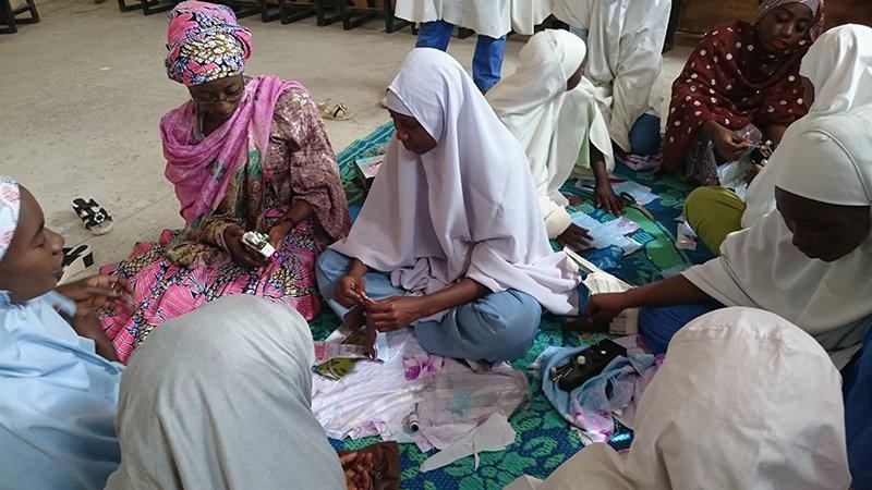 Girls making sanitary towels in Kano 2016. Photo credit: IWEI