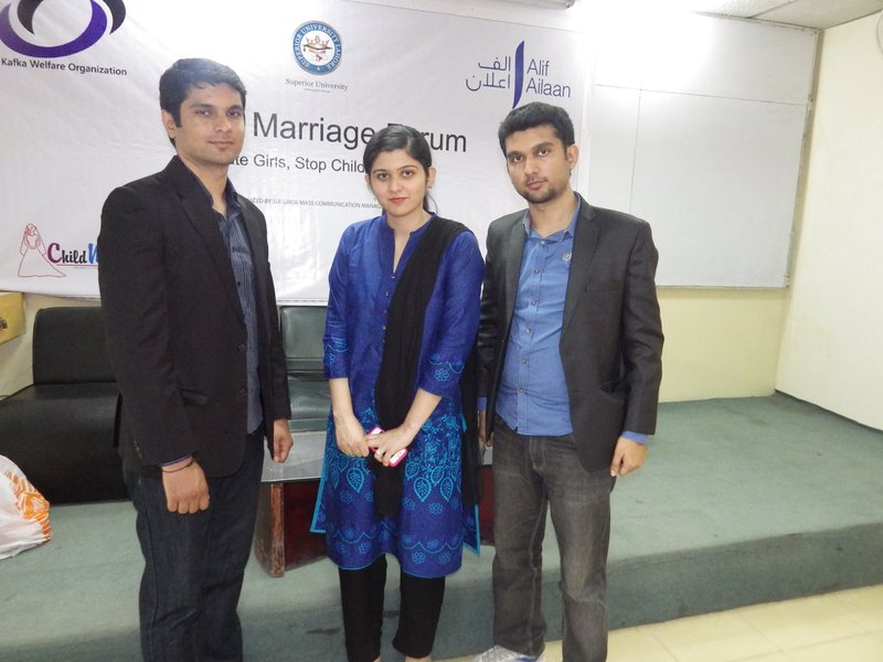 Iram (centre) with other activists