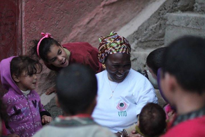 An activist from Mali talks to children during the caravan. Photo credit: Tariq Saiidi.