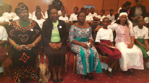 Ministers and sponsor representatives join local girls at the launch of the campaign. | Photo credit: Justine Kwachu