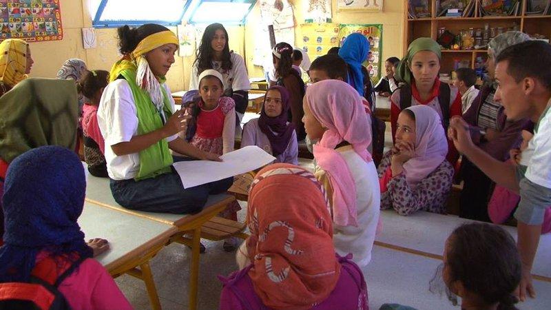 A drawing session with school children during the caravan. Photo credit: Tariq Saiidi.