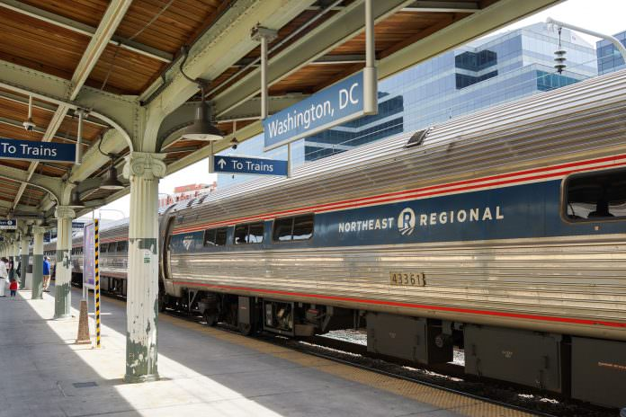 A Northeast Regional Amtrak train at the Union Station, Washington D.C.. Credit: Alan Tan Photography/ Shutterstock.