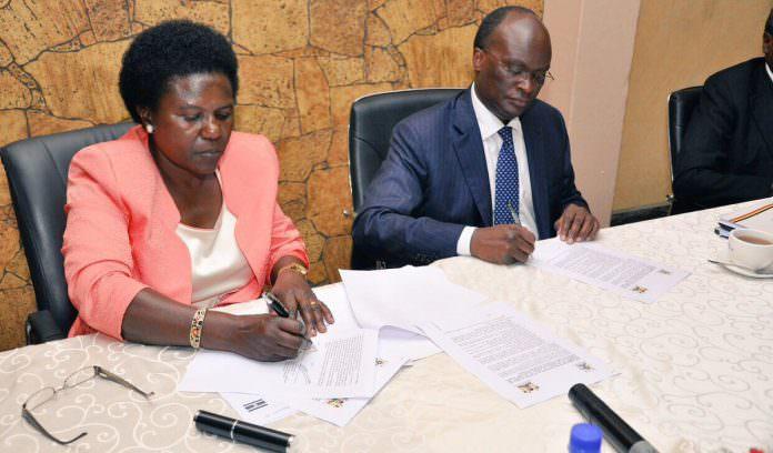 Ugandan minister for transport Monica Azuba (L) with Kenya'a cabinet secretary for transport James Macharia. Credit: SGR Uganda.
