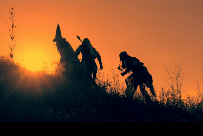 A wizard, a bowman and an axeman travel across grassland. Credit: LTE.