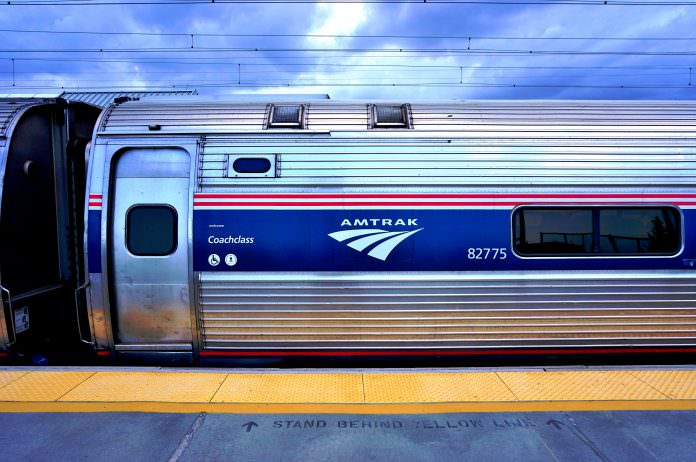 A Northeast Regional Amtrak train on the Northeast Corridor. Credi: EQRoy/Shutterstock.