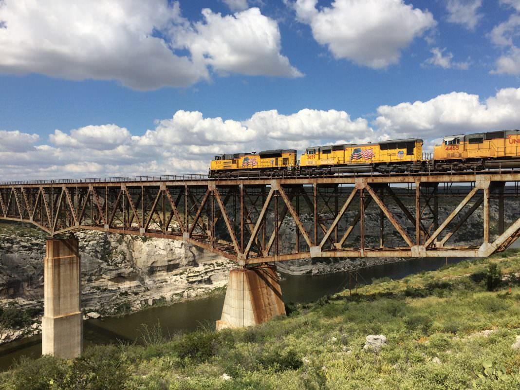 A Union Pacific locomotive crosses the Pecos River Bridge in Langtry, Texas. Credit: Union Pacific.