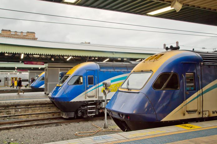 Three XPT trains wait at Central Station, Sydney. Credit: PomInOz/Shutterstock.