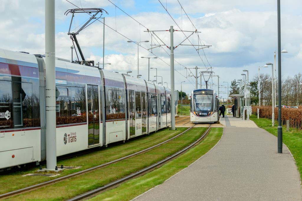 Two Edinburgh tramcars at Gyle Centre station to the west of the city. Credit: Cornfield/Shutterstock.