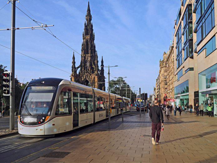 A tram on the Edinburgh tram network passing through Prince Street. Credit: Pete Spiro/Shutterstock.