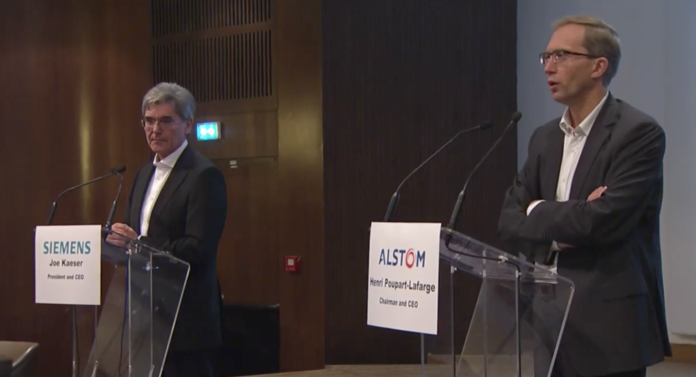 Alstom CEO Henri Poupart-Lafarge (R) takes questions from the world's media following the Siemens Alstom merger announcement in September. Credit: Siemens Alstom.