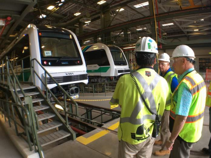 New HART CEO Andrew Robbins (far right) inspects rail cars at the rail operations centre. Credit: HART.