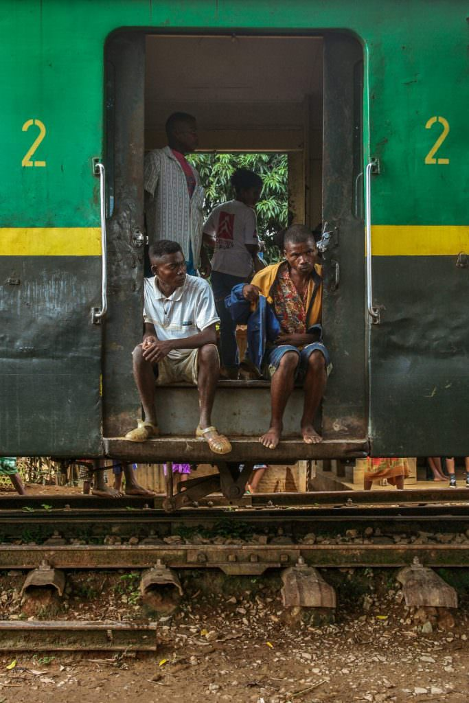 Passengers on board a train travelling on the Fianarantsoa-Côte Est railway in Madagascar (2013). Credit: Pierre-Yves Babelon/Shutterstock.