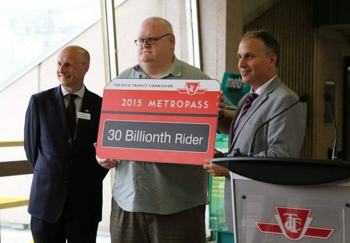 TTC's 30 billionth ride was taken by Grant Scott (centre) in 2015. Pictured alongside Andy Byford (Left) and chair Josh Colle. Photo: TTC.
