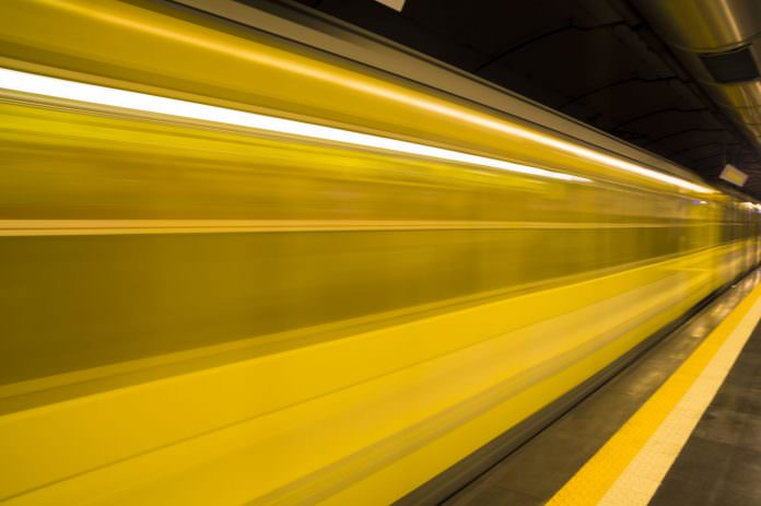 A blurred Naples metro train. Photo: ELEPHOTOS / Shutterstock.com.