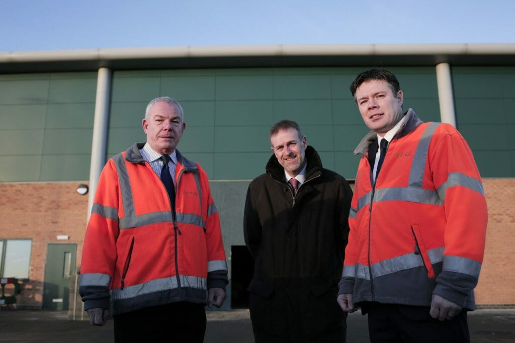 Rob Mason (left) and Steve Rowell of Vivarail with Business Durham's Peter Rippingale at the firm's new premises on Spectrum Business Park in Seaham, County Durham, UK. Photo: Vivarail.