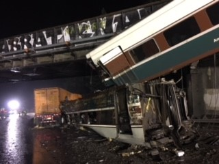 The derailed passenger train on Interstate 5. Photo: NTSB.