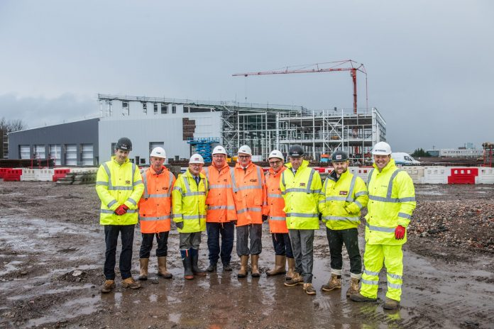 Members of the executive team from CAF alongside landowner and developer St Modwen and principal contractor Bowmer & Kirkland. Photo: CAF.
