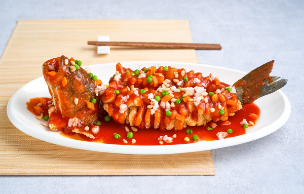 Crispy Sea Bass with Tomato sauce and Pine nuts